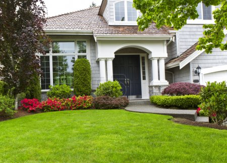 Green Front Yard and Flowers with Home