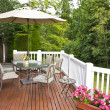 Outdoor patio setup on cedar wood deck with trees ...