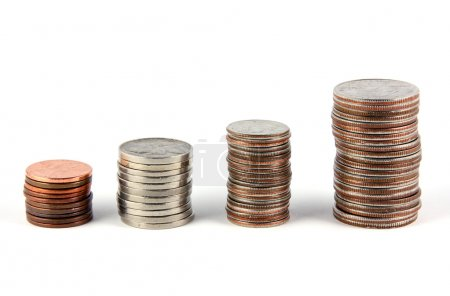Four stacks of coins (pennies, nickles, dimes, and...