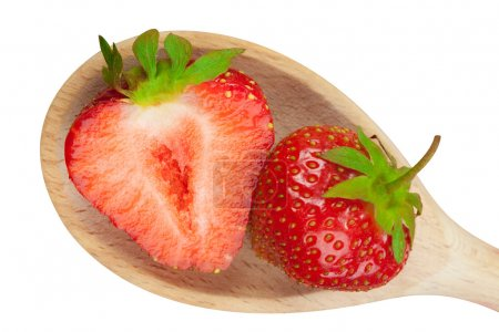 Two strawberries on a wooden spoon
