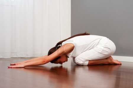 Woman doing daily yoga workouts