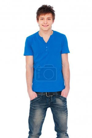 Photo for Smiley guy in blue t-shirt and jeans. isolated on white background - Royalty Free Image