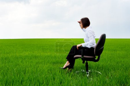 Serious businesswoman looking forward and having p...