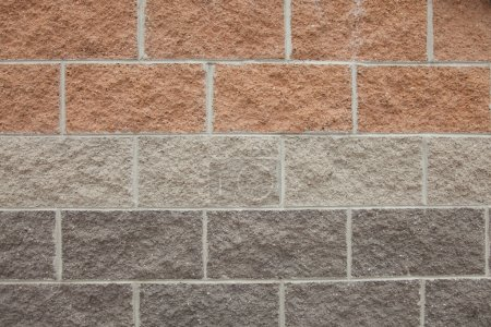 Photo for Close up of a wall made of rectangular coloured concrete blocks. - Royalty Free Image
