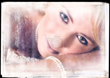 Photo for Romantic bride lying on a bed with vintage finish - Royalty Free Image