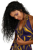 Beautiful African woman with long curly hair.