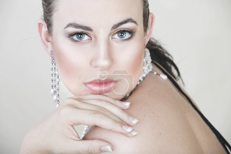 Beautiful young woman with silver jewellery.