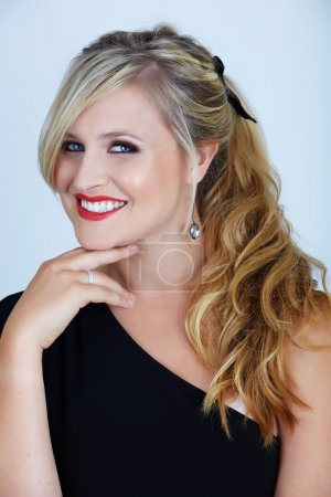 Photo for Young woman woth smoky bue eyes and long blond hair in off-shoulder black party dress - Royalty Free Image