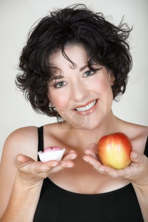 Woman with apple and a cake.