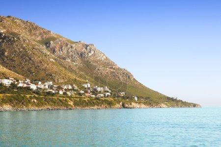 Houses next to ocean