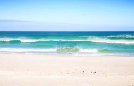 Photo for Sunny day on South African beach with big waves and clear blue sky - Royalty Free Image