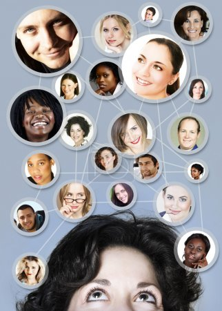 Photo for Young caucasian woman in her 30s with her social network friends and business partners in a diagram - Royalty Free Image