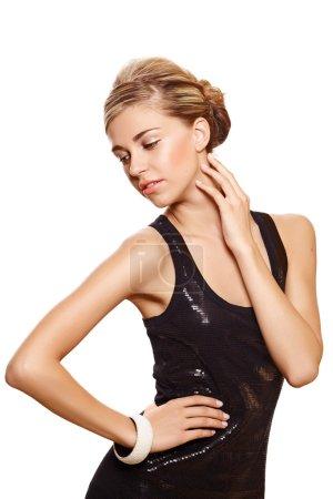 Beautiful woman in black fashion dress.