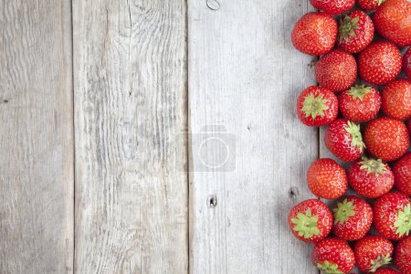 Photo for Fresh strawberries on old wooden background - Royalty Free Image
