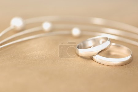 Photo for Wedding rings over silk - Royalty Free Image