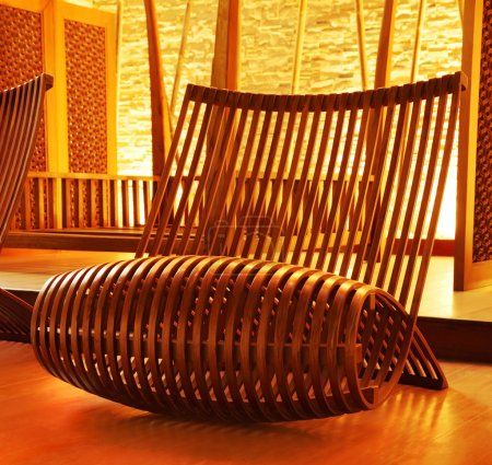 Photo for Wooden modern designed armchair with cozy warm lights - Royalty Free Image