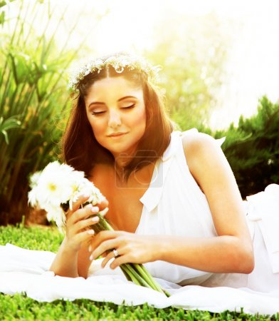 Photo for Happy bride lying on the grass, wedding day - Royalty Free Image