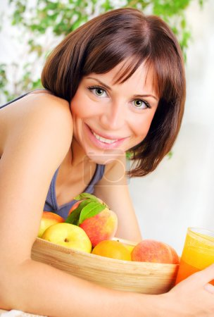 Photo for Portrait of healthy young woman with bowl of fresh fruits, concept of dieting, healthy eating & weight loss - Royalty Free Image