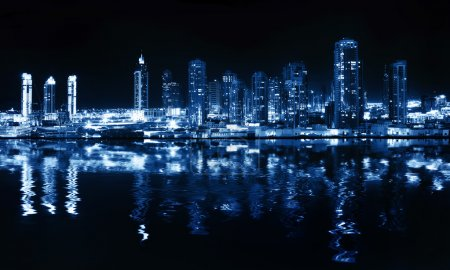 City at night, panoramic scene of downtown reflect...