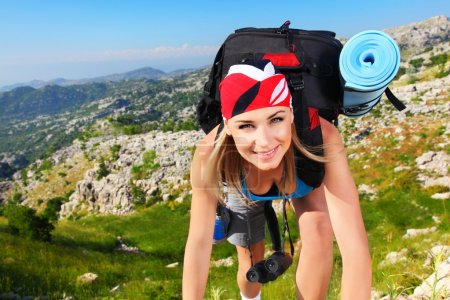 Photo for Traveling girl with backpack hiking in the mountains, freedom concept - Royalty Free Image