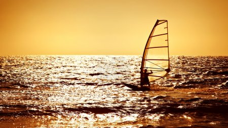 Photo for Windsurfer silhouette over sea sunset, panoramic beach landscape, summertime fun, sport, activities, vacation and travel concept - Royalty Free Image