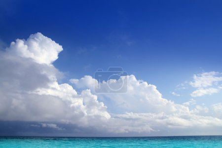 Caribbean aqua sea clouds in blue sky horizon