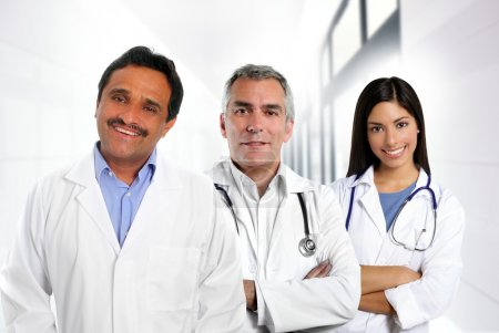 Photo for Doctors multi ethnic expertise indian caucasian latin in hospital - Royalty Free Image