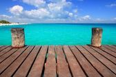 Caribbean wood pier with turquoise aqua sea