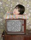 Retro pensive woman on vintage wooden tv 60s
