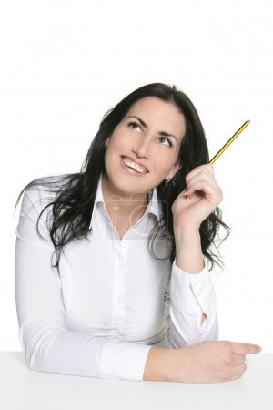 Brunette woman thinking with pencil isolated on white