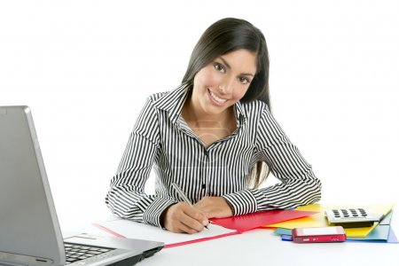 Beautiful secretary businesswoman writing on desk
