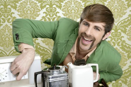 Photo for Geek retro man drinking tea coffee vintage teapot in wallpaper - Royalty Free Image