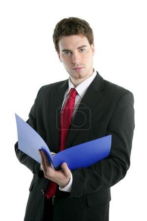 Photo for Businessman holding blue open folder over white studio background - Royalty Free Image