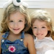 Two little beautiful toddler twin sisters portrait...
