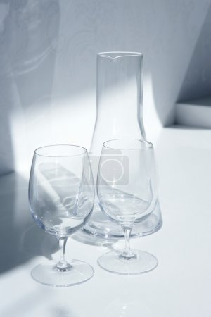 Photo for Water glass and bottle with transparent shadows in white kitchen - Royalty Free Image