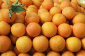 Valencia oranges stacked on market