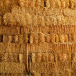 Golden straw bales stacked like big wall and tools...