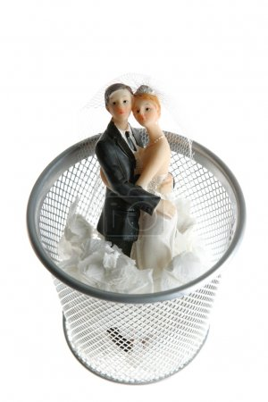 Wedding figurine on the paper trash