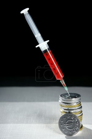 Euro currency syringe injection, financial metaphor