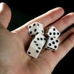Gambler five dices, luck metaphor over black backg...