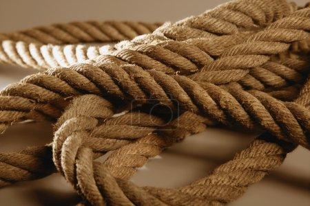 Old brown golden rough rope macro detail