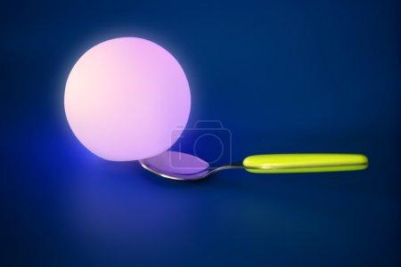 Glowing light sphere on a spoon