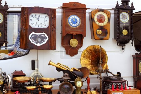 Photo for Antiques fair market wall old clocks vintage stuff - Royalty Free Image