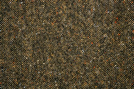 Cheviot tweed fabric background texture on brown c...