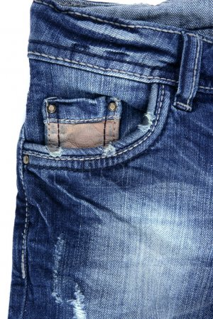 Denim blue jeans pocket detail closeup texture