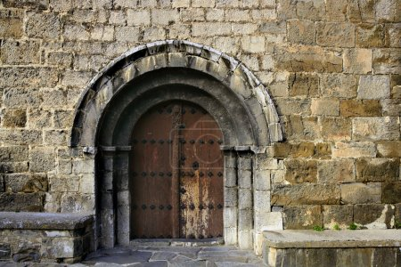 Photo for Ancient stone arch romanic architecture church in Spain Pyrenees - Royalty Free Image