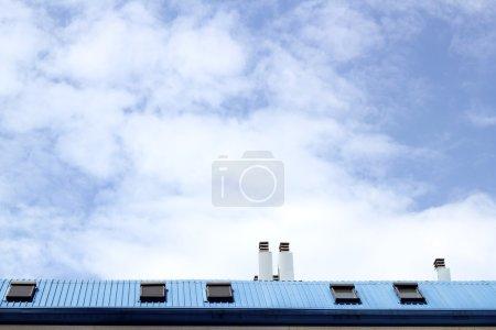 Blue steel roof skylight windown chimney sky