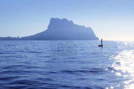 Ifach Penon mountain from Calpe blue fog backlight