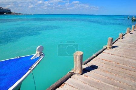 Boat in wood pier Cancun tropical Caribbean sea
