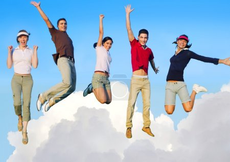 Jumping young happy group flying in sky